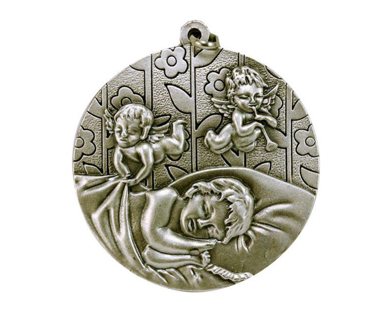 Medallón Niño c/angelitos 6cm  fundicion